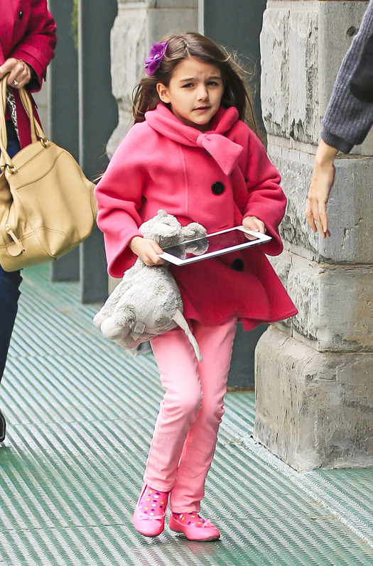 Suri Cruise holds her iPad with her teddy bear as she enters the i-Plaza nail salon with mom Katie Holmes and grandma Kathleen Holmes in New York City. Pictured: Suri Cruise Ref: SPL530012  200413   Picture by: Splash News Splash News and Pictures Los Angeles:310-821-2666 New York:212-619-2666 London:870-934-2666 photodesk@splashnews.com