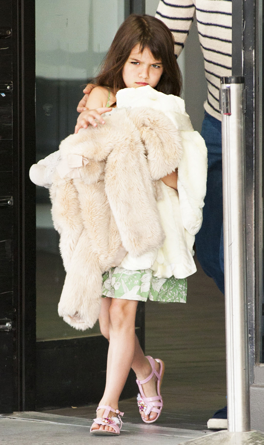Katie Holmes and Suri arriving at JFK Airport in New York. Pictured: Suri Cruise Ref: SPL551374  270513   Picture by: Mejia / Asadorian / Splash News Splash News and Pictures Los Angeles:310-821-2666 New York:212-619-2666 London:870-934-2666 photodesk@splashnews.com