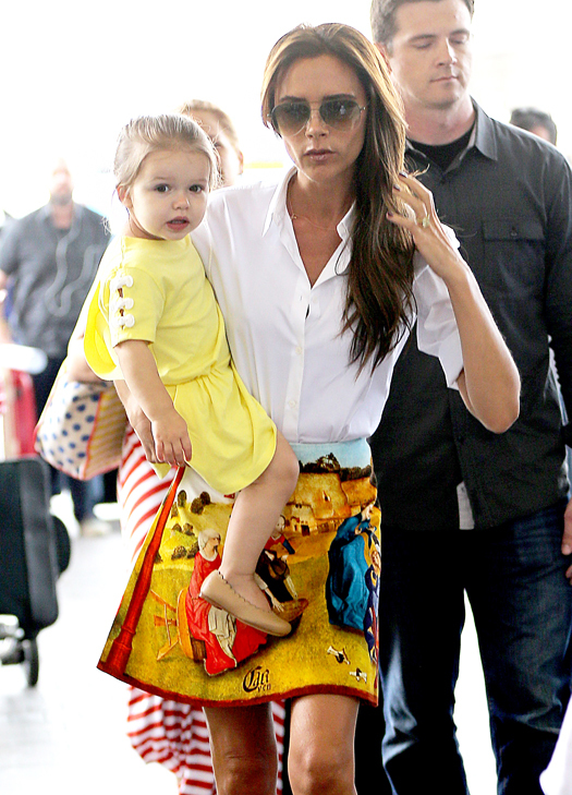 Victoria Beckham and kids fly out of LAX Airport. Pictured: Victoria Beckham and Harper Beckham Ref: SPL554051  010613   Picture by: All Access Photo / Splash News Splash News and Pictures Los Angeles:310-821-2666 New York:212-619-2666 London:870-934-2666 photodesk@splashnews.com