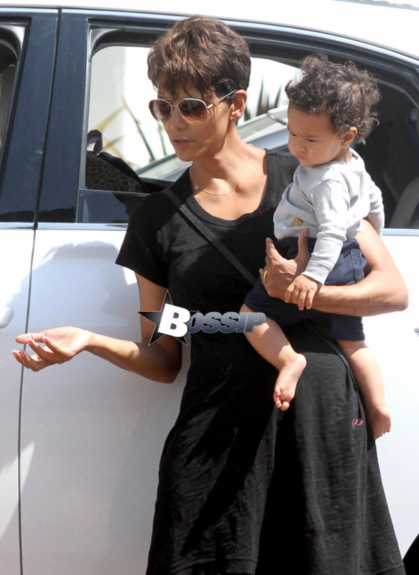 *EXCLUSIVE* **SHOT ON 7/5/14** Los Angeles, CA - Halle Berry steps out with her 9 month old son, Maceo this afternoon for some mother-son time.  The actress carried her little boy in one arm while holding a giraffe toy in hand.  It looks like Maceo wanted his favorite toy had his eyes on it the whole time.  Halle was dressed for the warm weather wearing a black high-low dress, which revealed what may possibly a baby bump.  Could Halle be pregnant with her third child?  AKM-GSI          July 5, 2014 To License These Photos, Please Contact : Steve Ginsburg (310) 505-8447 (323) 423-9397 steve@akmgsi.com sales@akmgsi.com or Maria Buda (917) 242-1505 mbuda@akmgsi.com ginsburgspalyinc@gmail.com