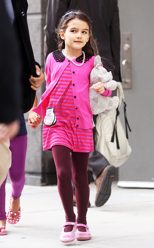 Suri Cruise is all smiles as she goes on a playdate with a friend in Battery Park City wearing all pink while carrying her stuffed elephant and wearing beads around her neck in New York City on Monday afternoon.  Pictured: Suri Cruise Ref: SPL530809  220413   Picture by: Splash News Splash News and Pictures Los Angeles:310-821-2666 New York:212-619-2666 London:870-934-2666 photodesk@splashnews.com