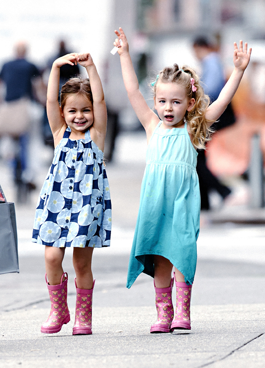 Sarah Jessica Parker's twin daughters Marion and Tabitha seen with arms stretched out playing in the wind on the way to school in NYC. Pictured: Marion Broderick and Tabitha Broderick Ref: SPL558816  110613   Picture by: Jason Webber / Splash News Splash News and Pictures Los Angeles:310-821-2666 New York:212-619-2666 London:870-934-2666 photodesk@splashnews.com