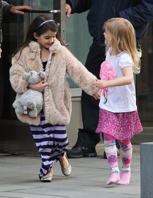 Suri Cruise has a play date in New York and the pair leave an apartment holding hands together as they said goodbye to eachother. The girls seemed very excited about their day, whilst mother Katie Holmes went for biker chic wearing a studded bikers jacket. Pictured: Suri Cruise Ref: SPL508266  100313   Picture by: Splash News Splash News and Pictures Los Angeles:310-821-2666 New York:212-619-2666 London:870-934-2666 photodesk@splashnews.com
