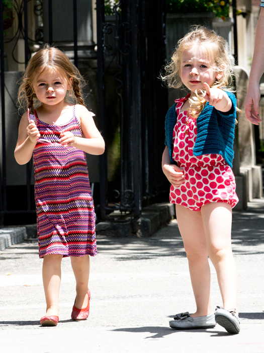 Sarah Jessica Parker's twin daughters walk home from school with their nanny in Greenwich Village, NYC. One of the twins had problems with her sunglasses so she adjusted them. Pictured: Tabitha Broderick and Marion Broderick Ref: SPL560295  120613   Picture by: TD / Splash News Splash News and Pictures Los Angeles:310-821-2666 New York:212-619-2666 London:870-934-2666 photodesk@splashnews.com