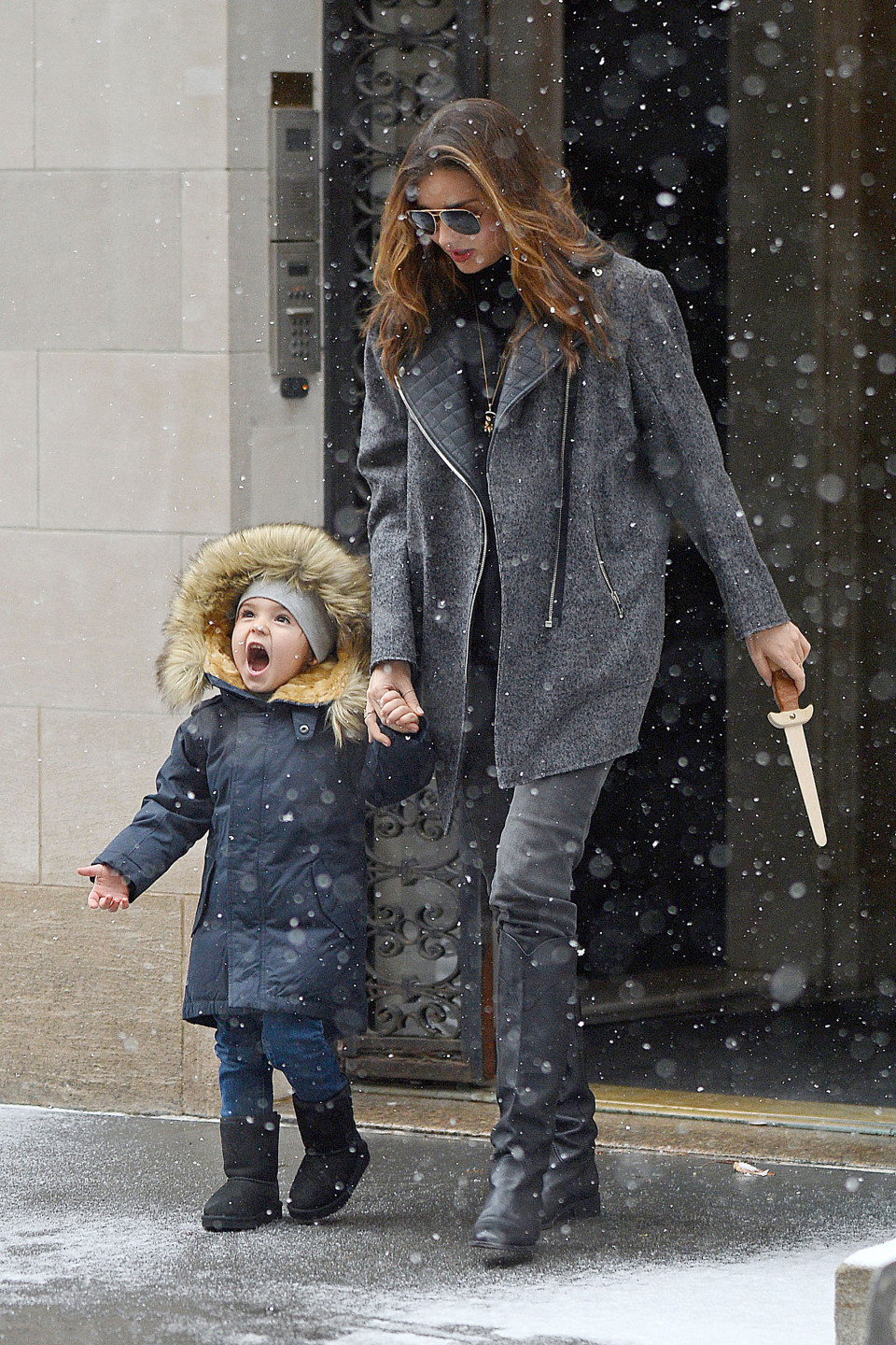 *EXCLUSIVE* New York, NY - Miranda Kerr and her adorable son, Flynn step out on a snowy day in New York this afternoon.  Flynn looked very happy and excited to see the snow fall and even opened up his mouth wide to get a taste, which gave his mom a good laugh.  Miranda looked pretty covered up in grey and black and carried Flynn's toy sword in hand as the pair walked to their car.  AKM-GSI        December 14, 2013 To License These Photos, Please Contact : Steve Ginsburg (310) 505-8447 (323) 423-9397 steve@akmgsi.com sales@akmgsi.com or Maria Buda (917) 242-1505 mbuda@akmgsi.com ginsburgspalyinc@gmail.com